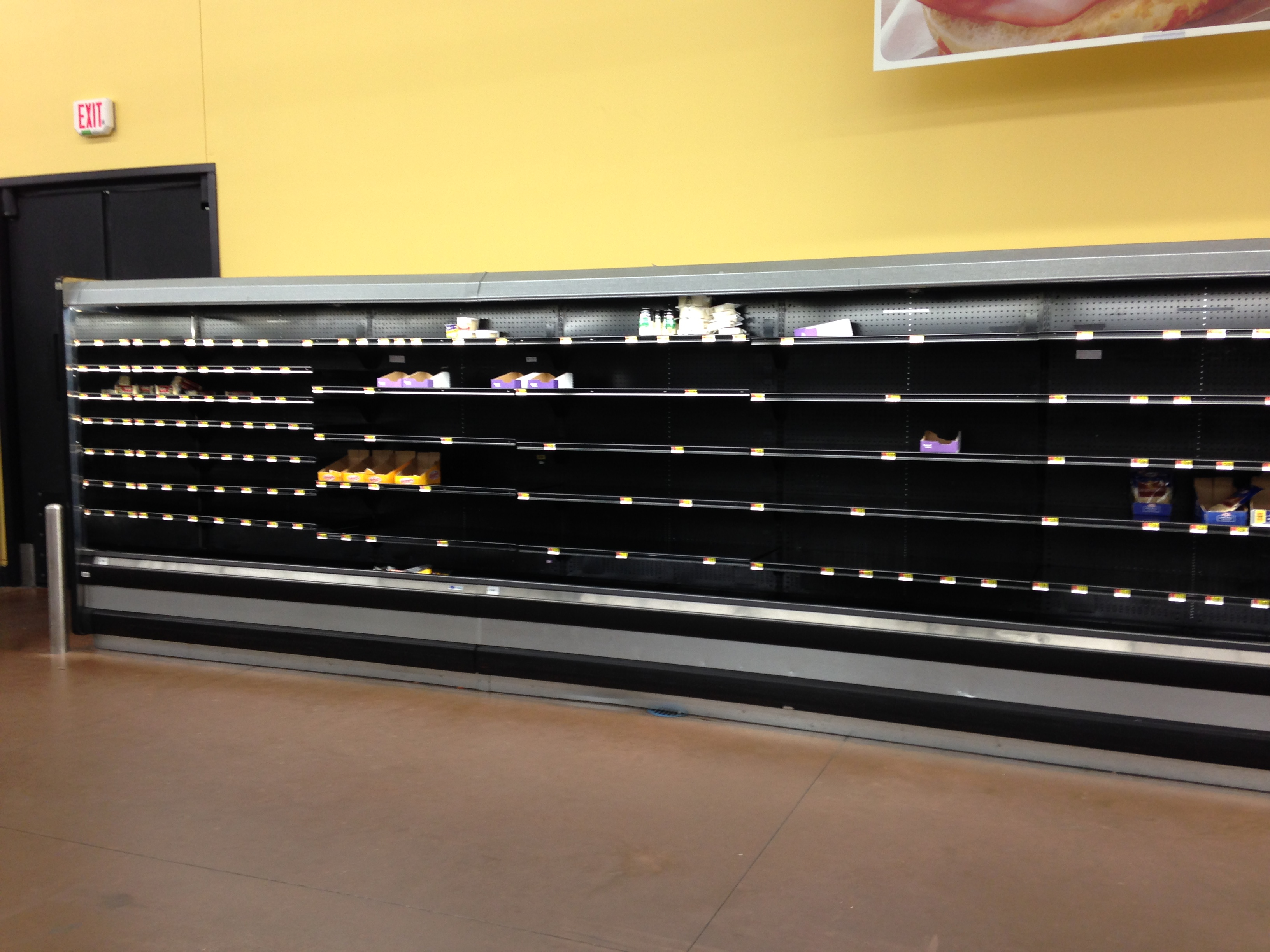 picture of empty cheese shelf.