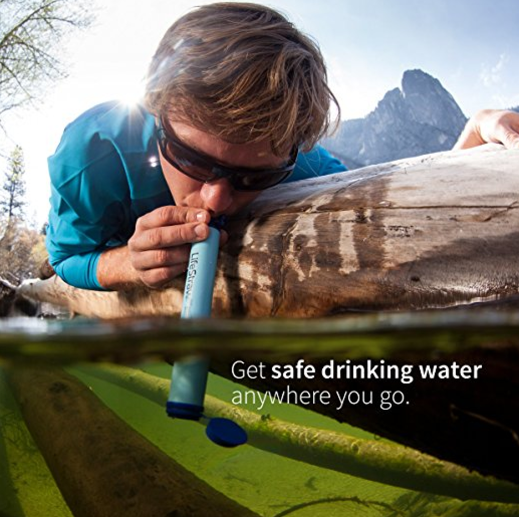 Picture of a man using the life straw
